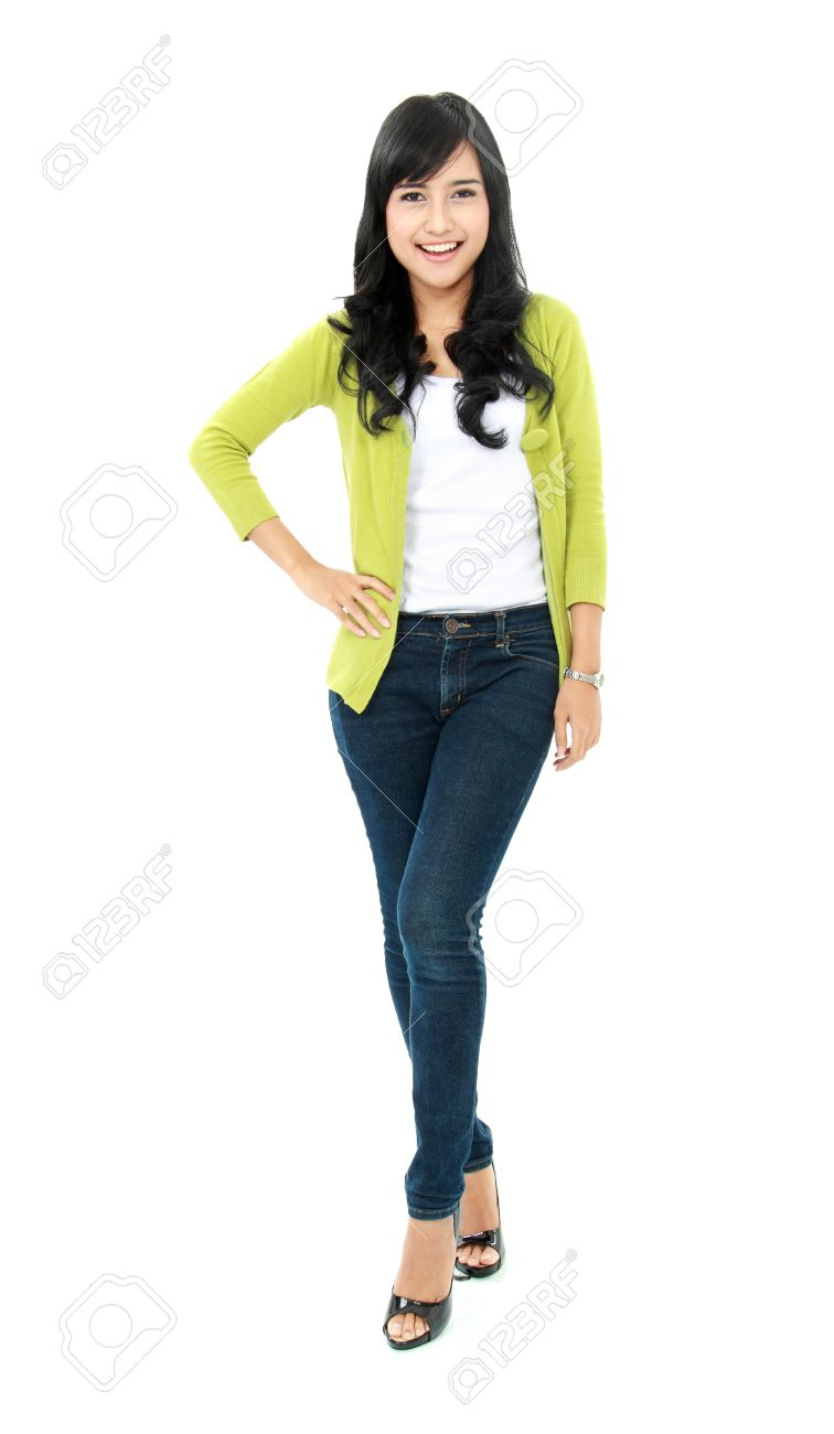 Full body portrait of a young girl looking at camera stock photo 16245041