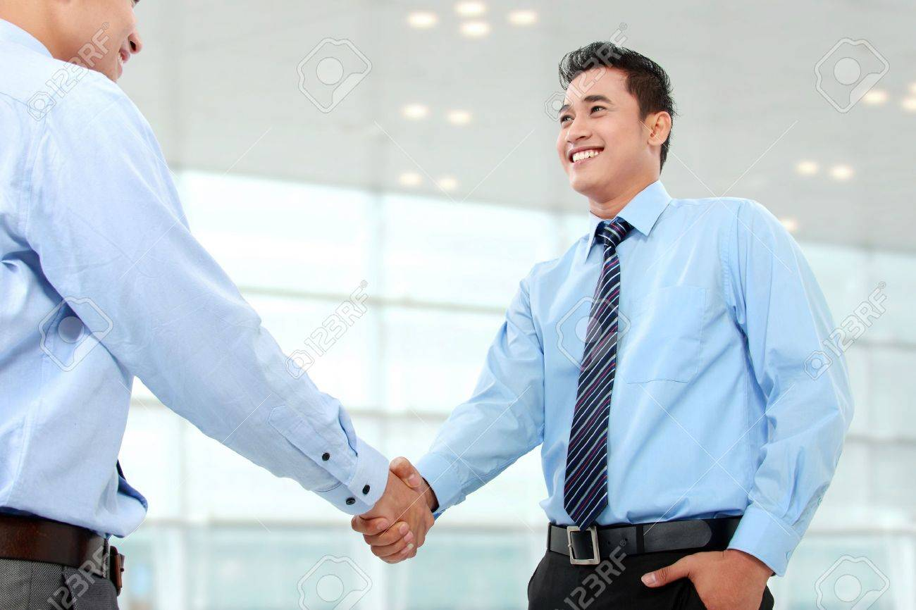 portrait of successful business man shaking hands with eachother