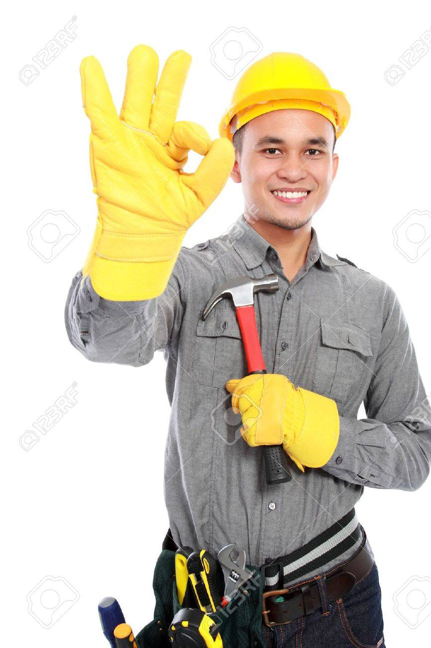 Portrait of young worker with tool belt giving you thumbs up Stock Photo - 17685938