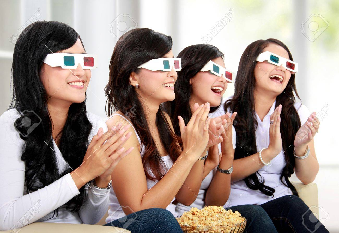 Group of girls clapping watching good 3D movie in home theater Stock Photo - 18121726