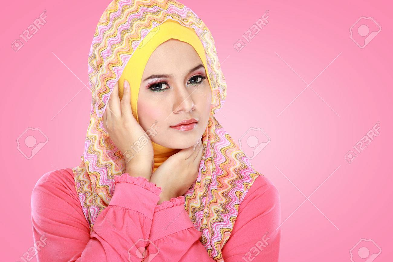 Fashion portrait of young beautiful muslim woman wearing pink Stock Photo - 22671158