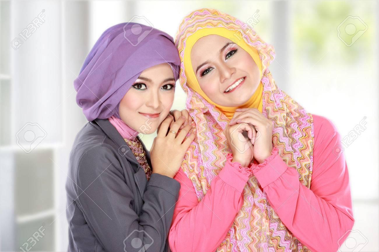 Portrait of two beautiful muslim woman having fun at home Stock Photo - 22671177