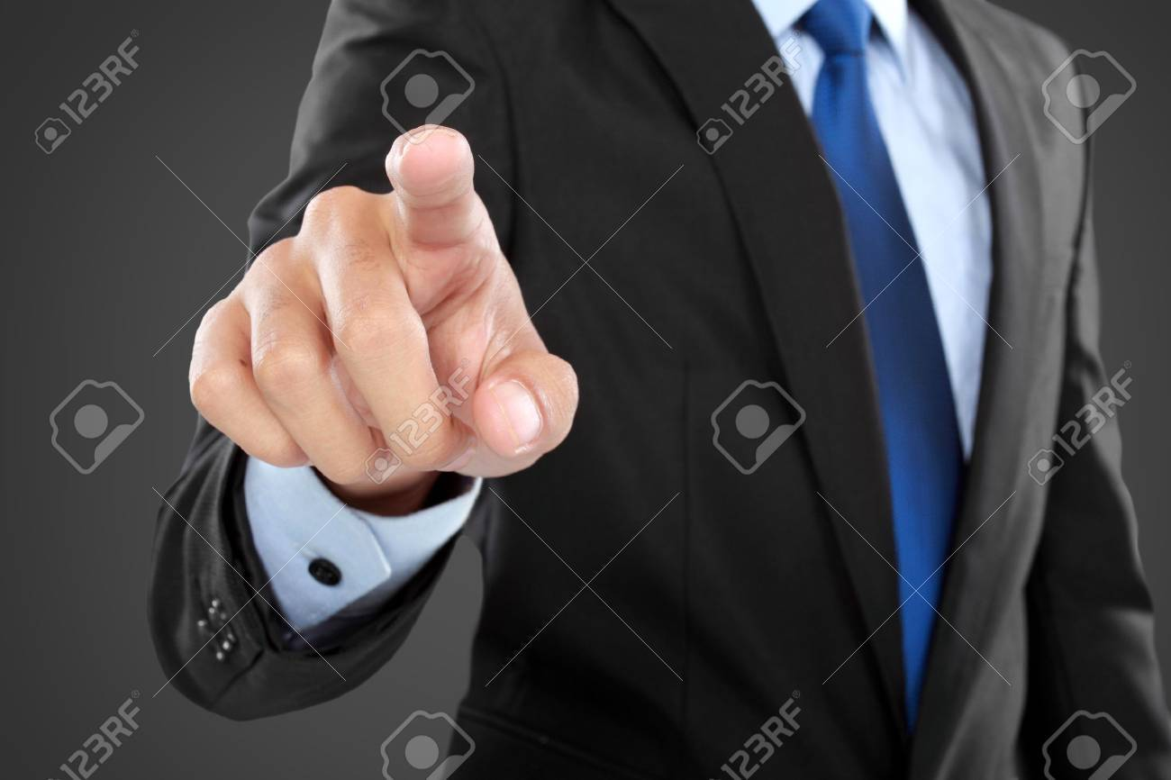 Business Man pushing on a touch screen interface  against black background Stock Photo - 24980173