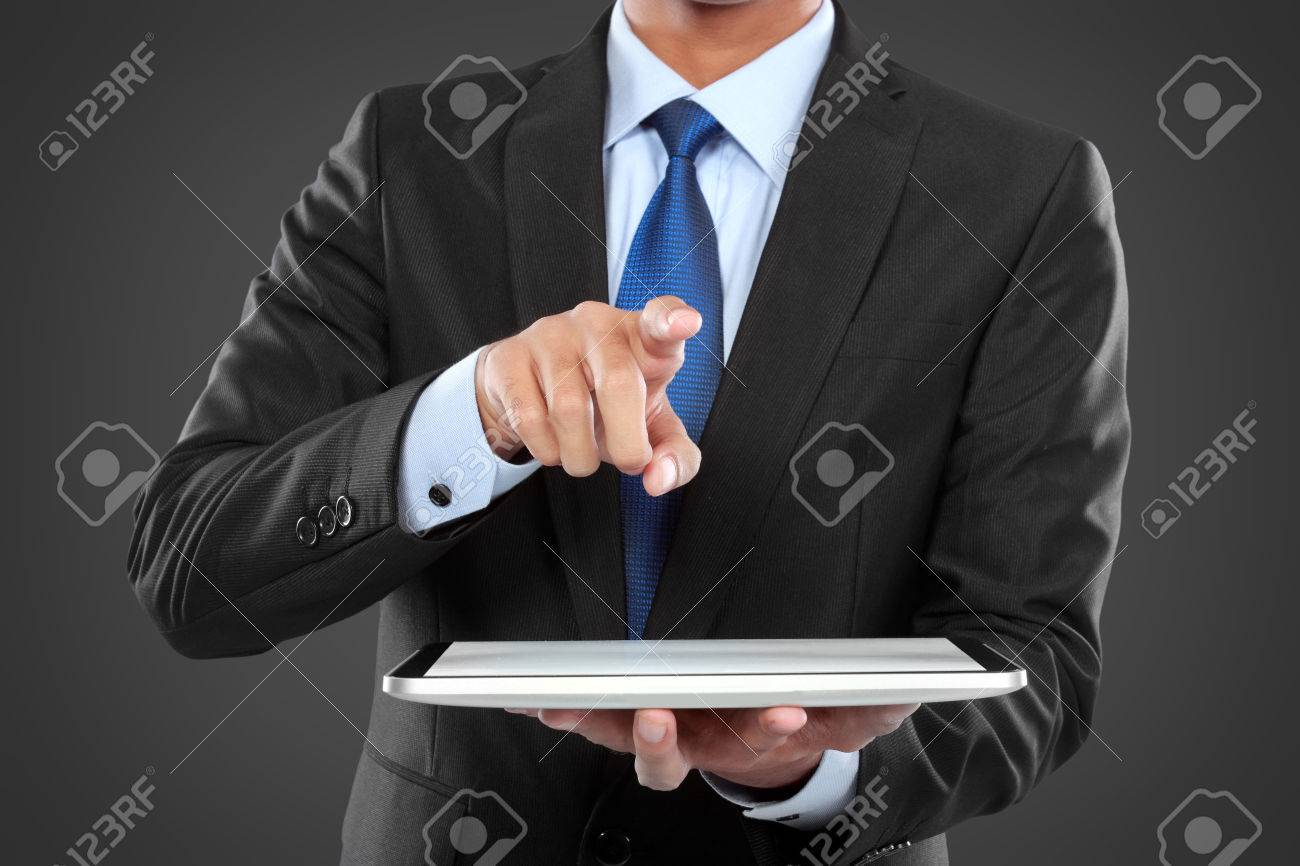 photo of a businessman showing blank tablet PC monitor while pushing to virtual screen Stock Photo - 24980177
