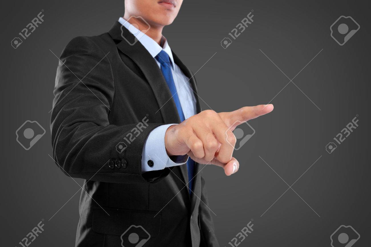 Business Man pushing on a touch screen interface  against black background Stock Photo - 24980205