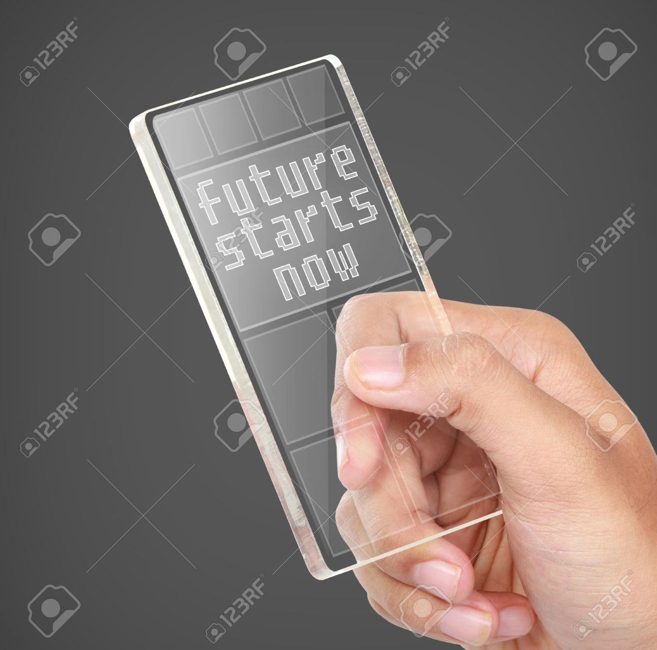 future technology in mobile phones. image of hands holding futuristic transparent mobile phone. future technology concept stock photo - 27387541 in phones