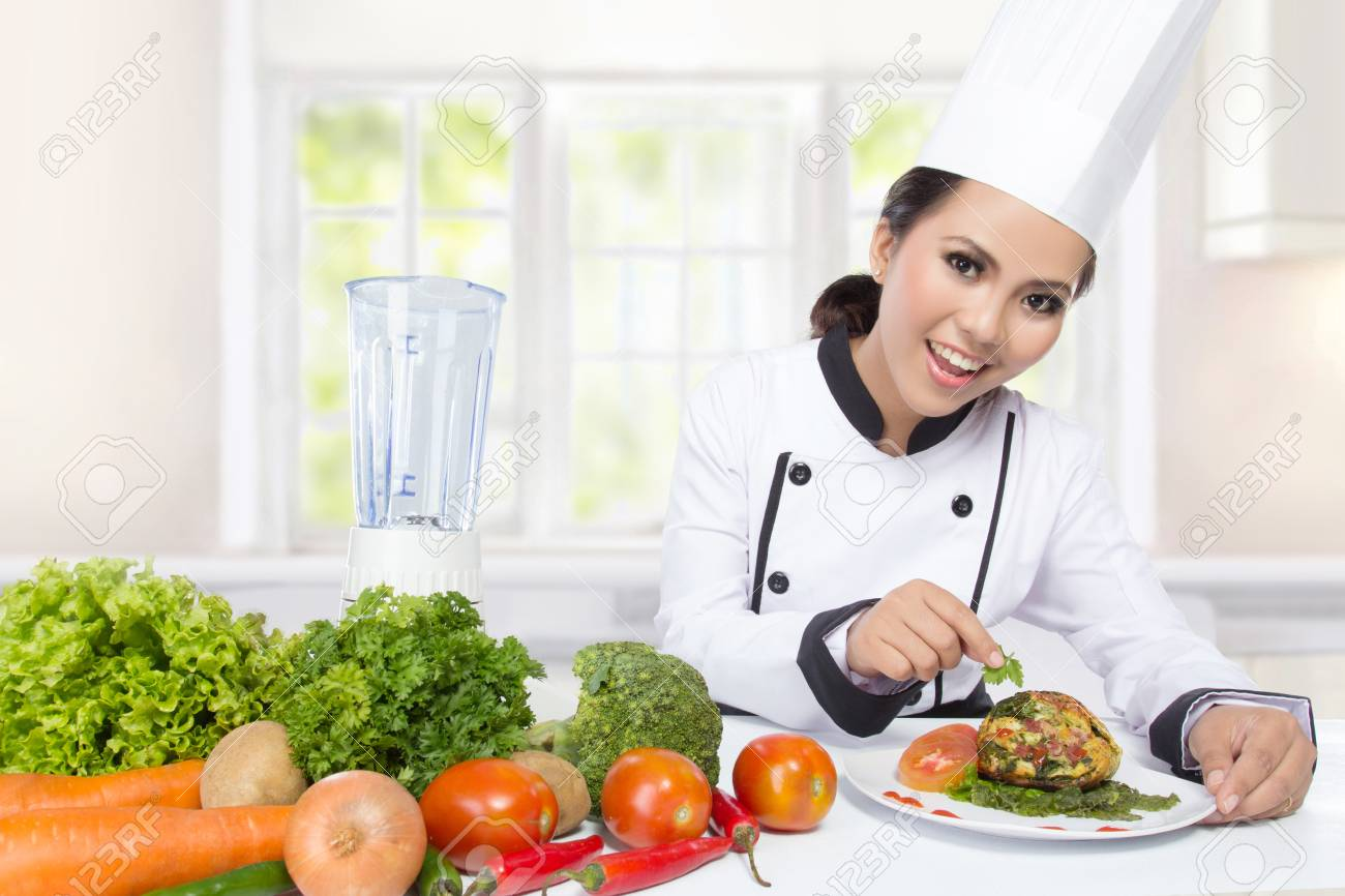 Female Chef Cooking In The Kitchen. Healthy Food Diet. Prepare ...