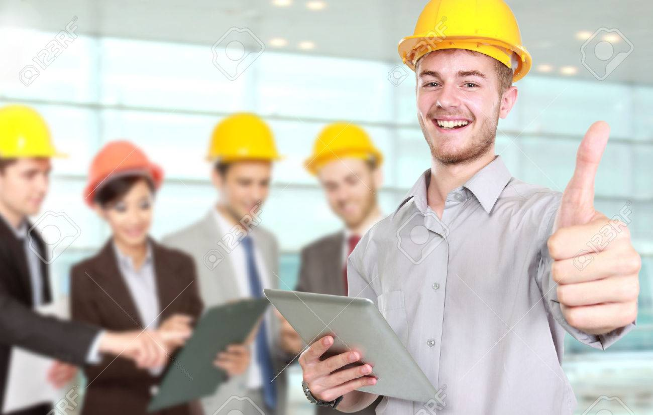 A portrait of a young businessman wear a safety helmet showing thumb up Stock Photo - 50862327