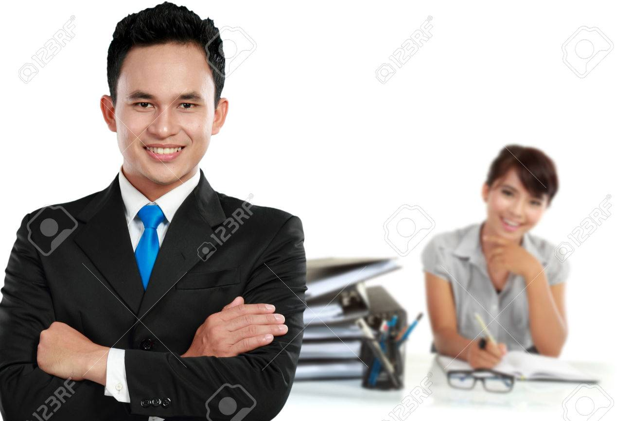 a portrait of asian young businessperson as a team leader his a portrait of asian young businessperson as a team leader his secretary at the background