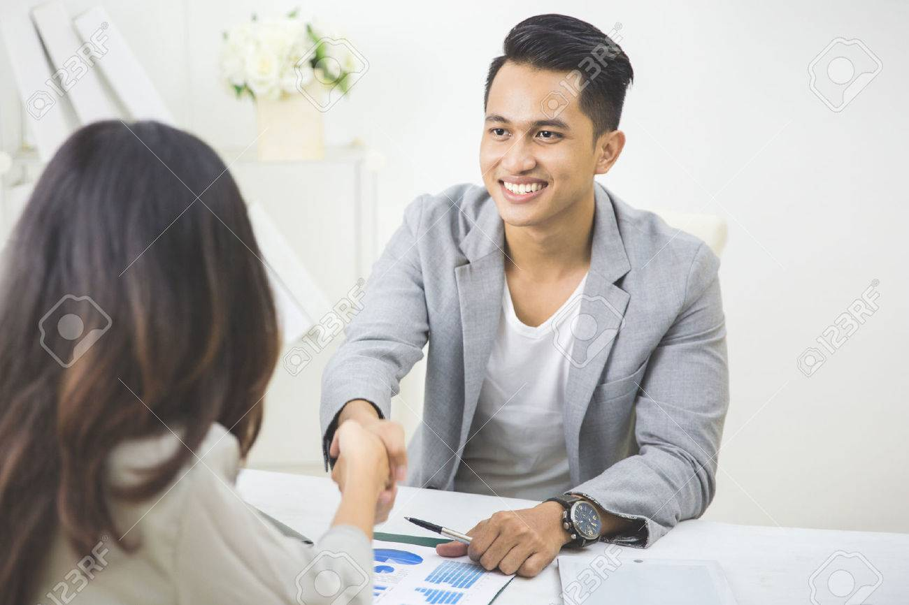 portrait of business partner make a deal in the office. shake hand Stock Photo - 53046121
