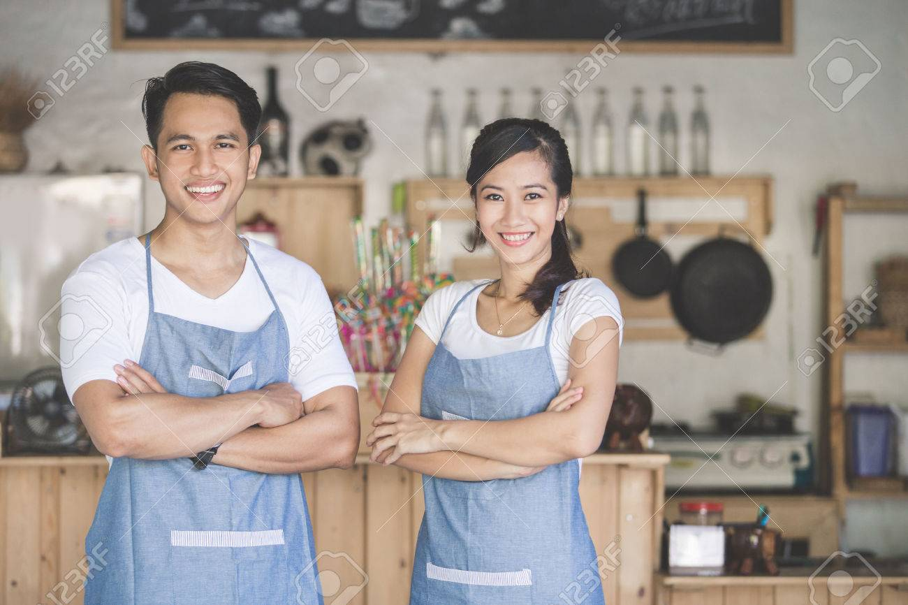 Successful small business owner proudly standing in front of their cafe Stock Photo - 54110677