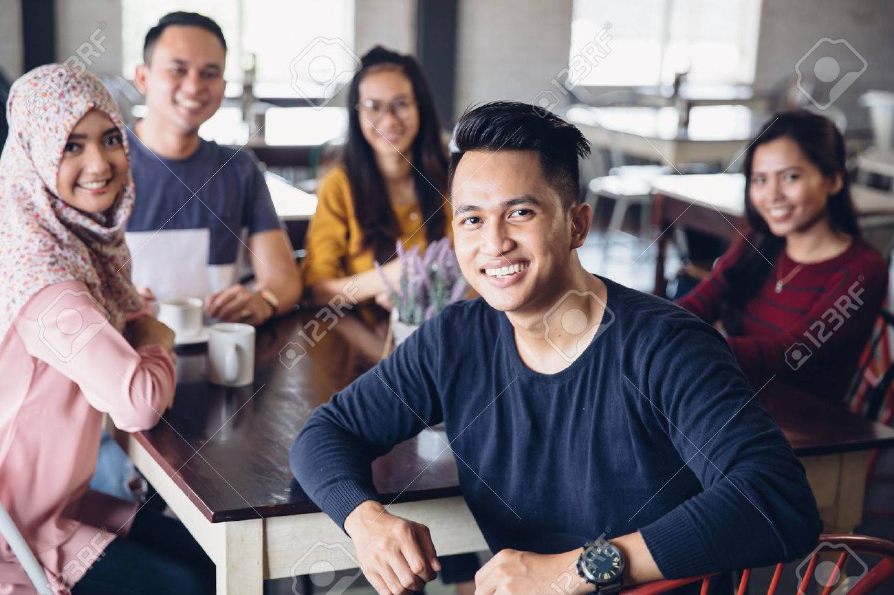 portrait of friends having fun together in a cafe. looking at camera Stock Photo - 54703689