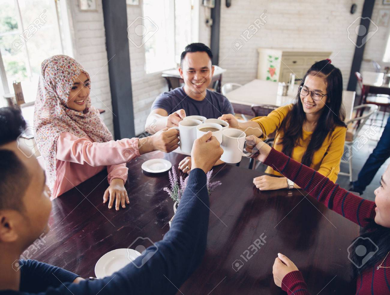 happy Diverse Friends Cheering With Coffee at cafeteria - 54703686