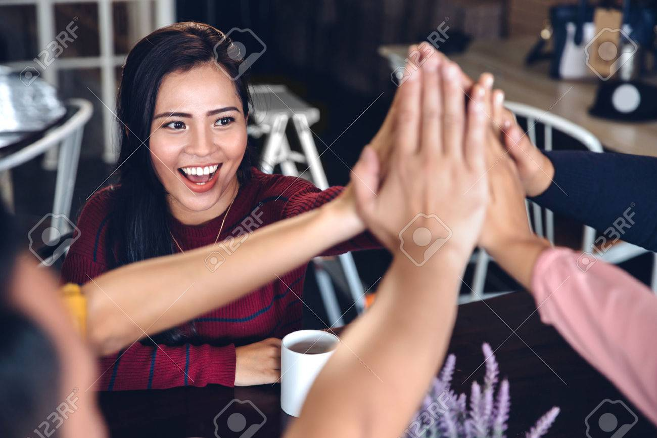 portrait of young enthusiastic team giving high five Stock Photo - 54704451