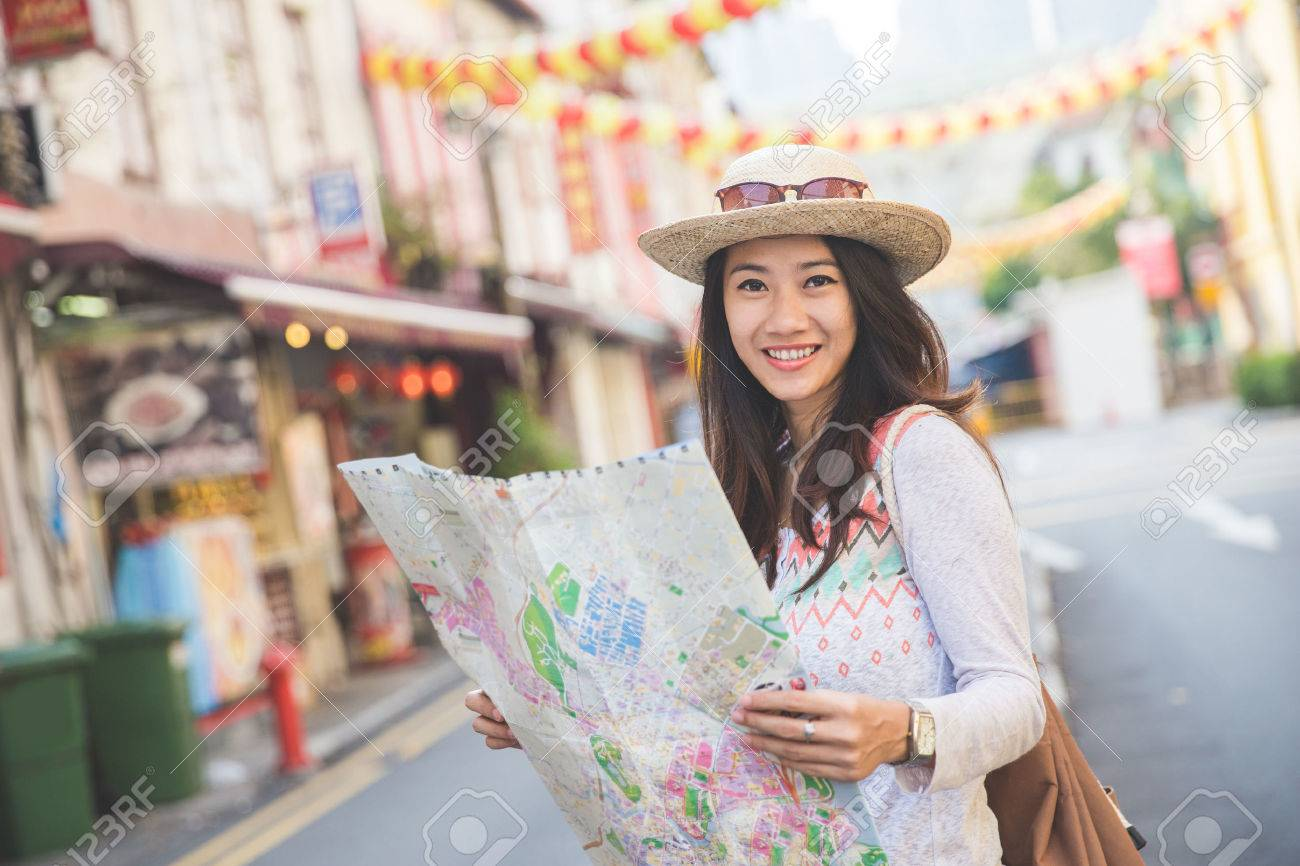 Happy travel woman look map and looking at camera Stock Photo - 55577295