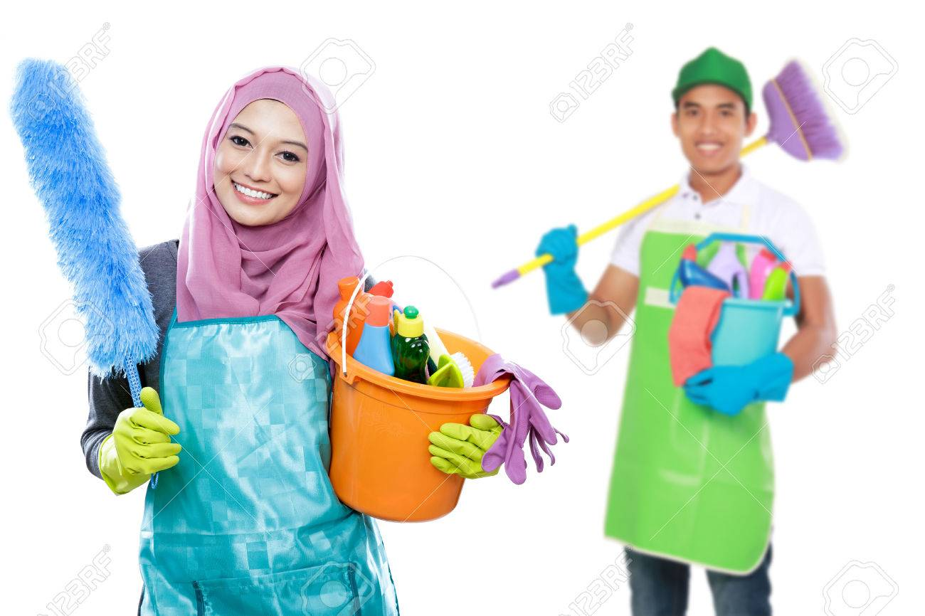Attractive Muslim Housewife Ready To Do The Chores. Housework Cleaning  Concept. Male With Cleaning