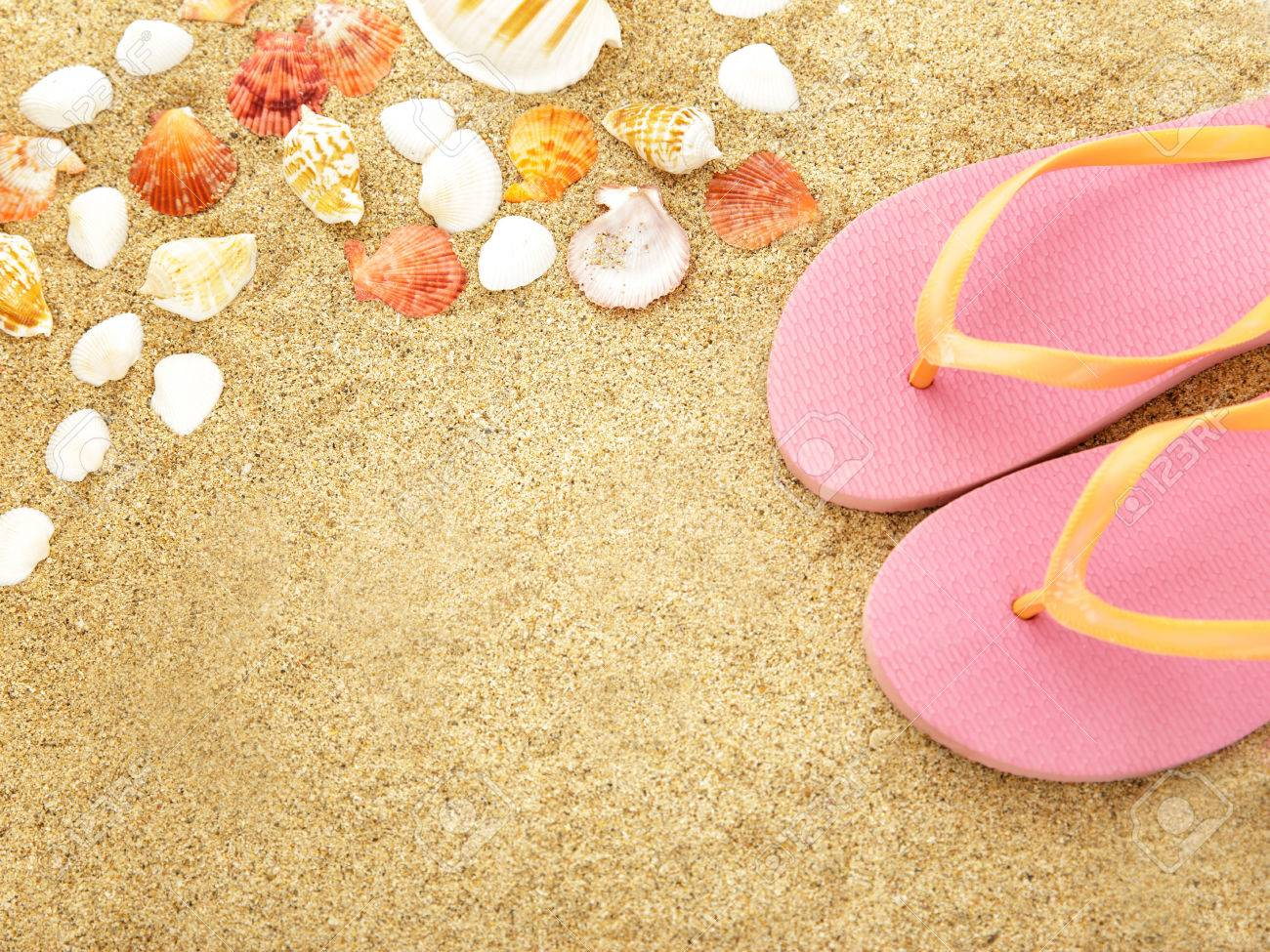 47b9c77060d0 Stock photo top view portrait of pink flip flops with sea shells on beach  sand jpg
