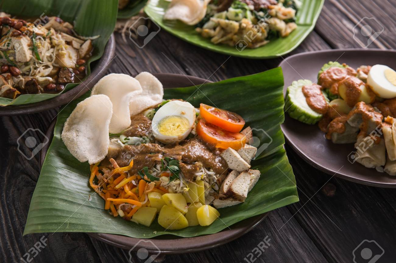 Gado Gado Traditional Indonesian Food Rice Cake Egg And Vegetable With Peanut Sauce Stock Photo Picture And Royalty Free Image Image 104696191