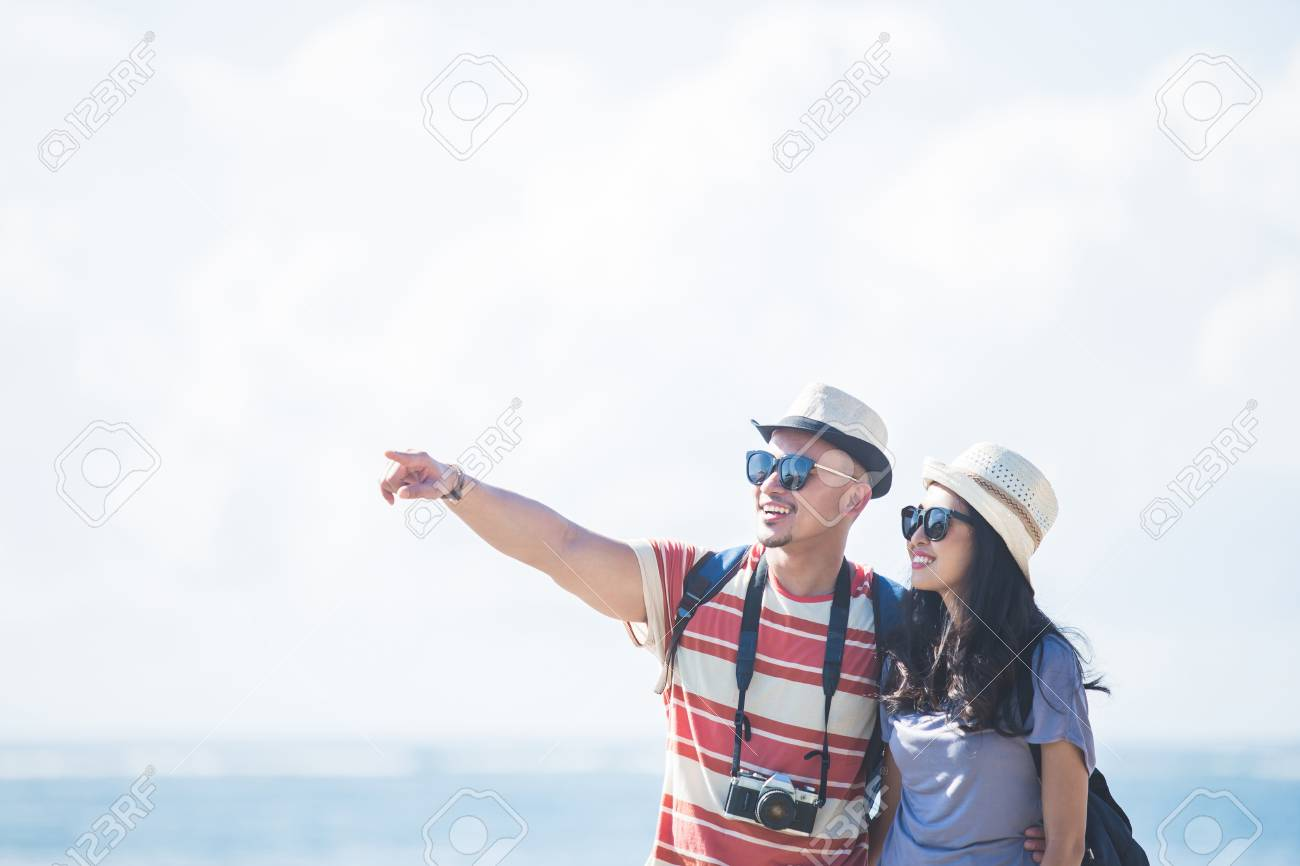 young backpacker with his partner pointing at something during s - 108150723