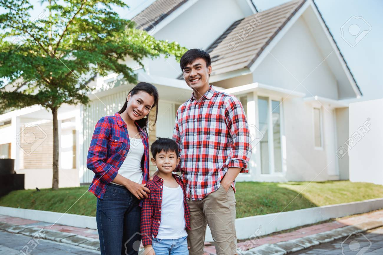 asian family with kid portrait in front of their house - 119501379