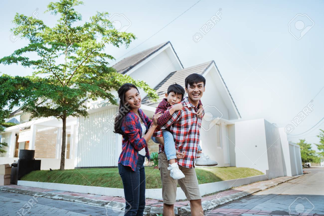 father piggyback ride with his son in front of the house - 121437792