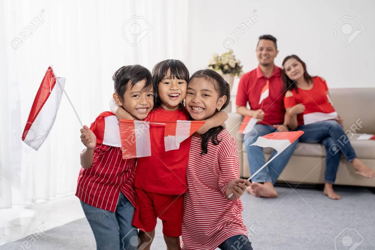 family indonesia celebrating independence day - 127831954