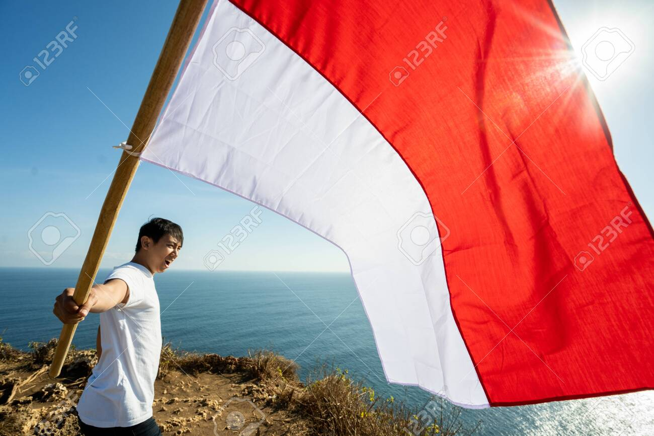 asian male with indonesian flag celebrating independence day - 128188780