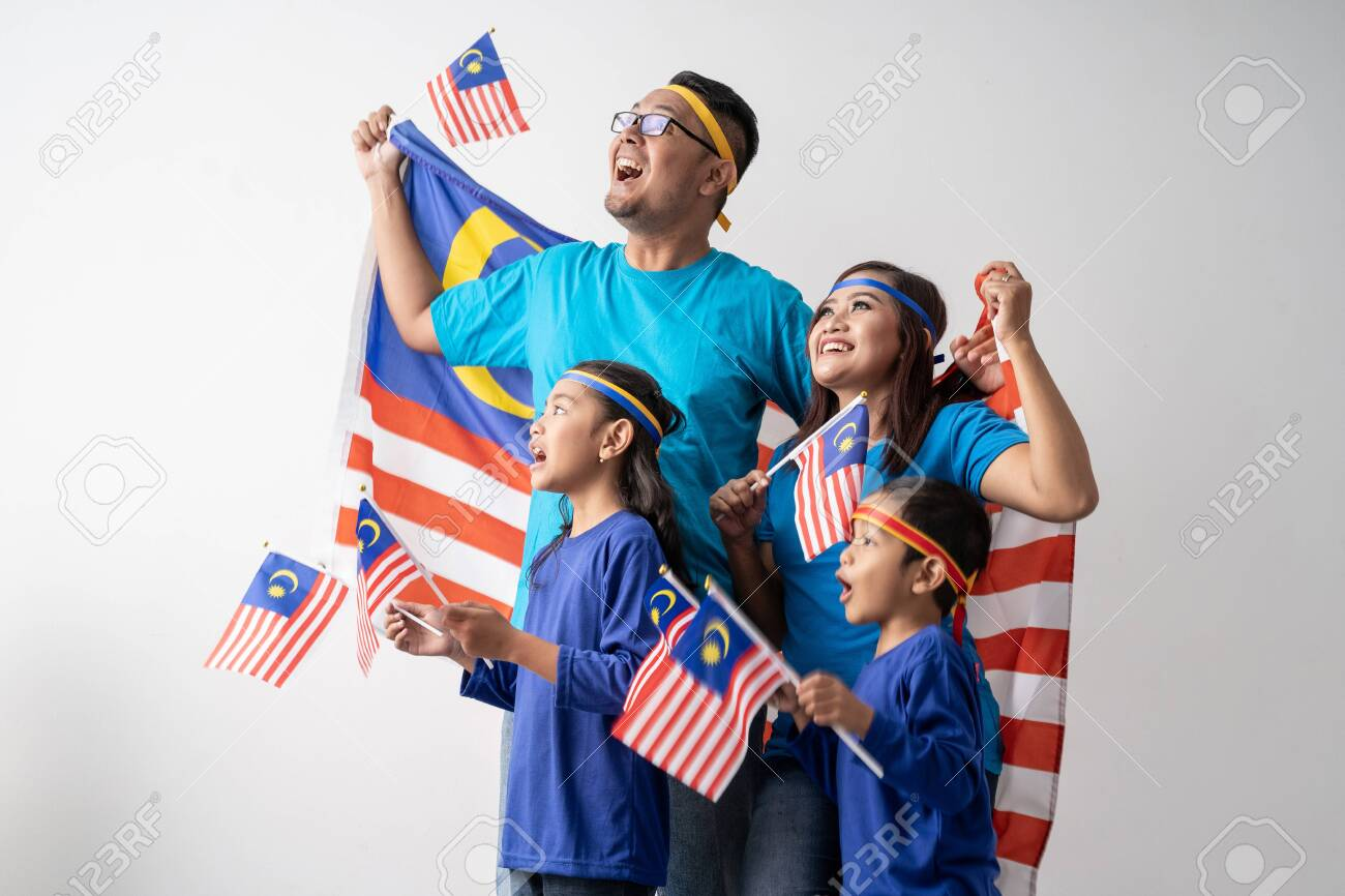 malaysia family with attributes and flag celebrating - 128977752