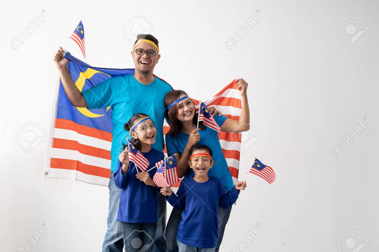 malaysian family holding malaysia flag over white background - 128978824