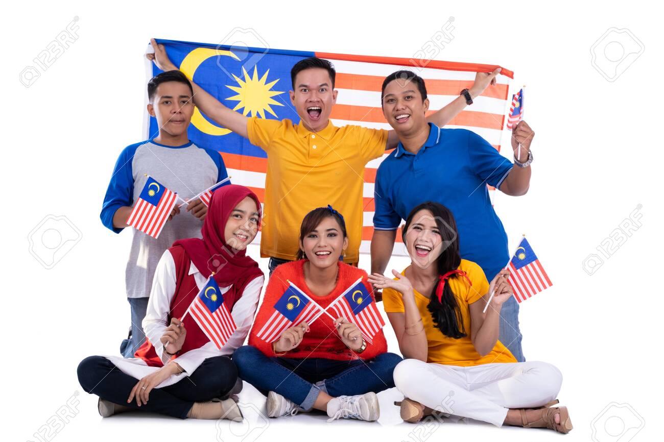 People holding malaysia flag celebrating independence day - 128600742