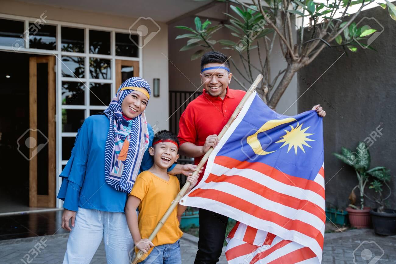 Malaysian family celebrating malaysia independence day - 128601925