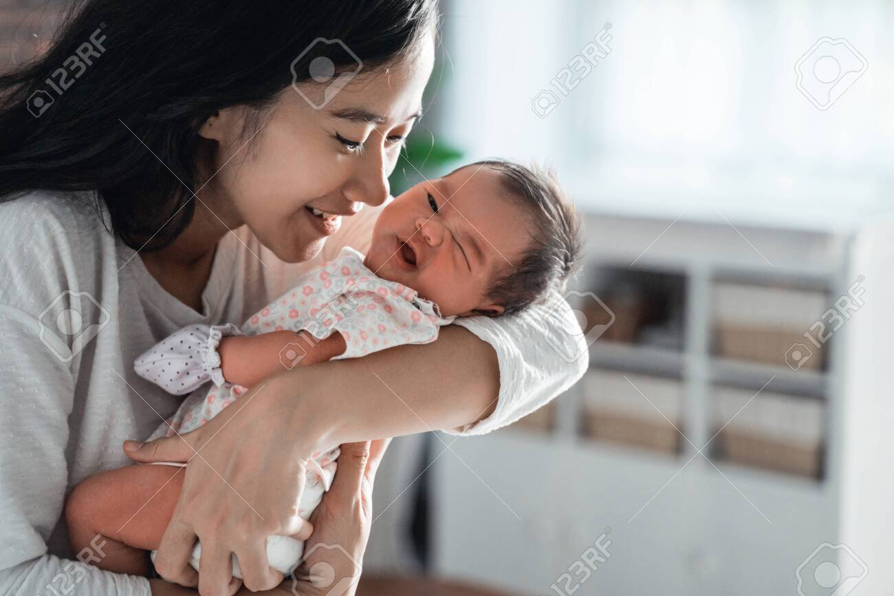 mother kissing her little daughter - 129696497