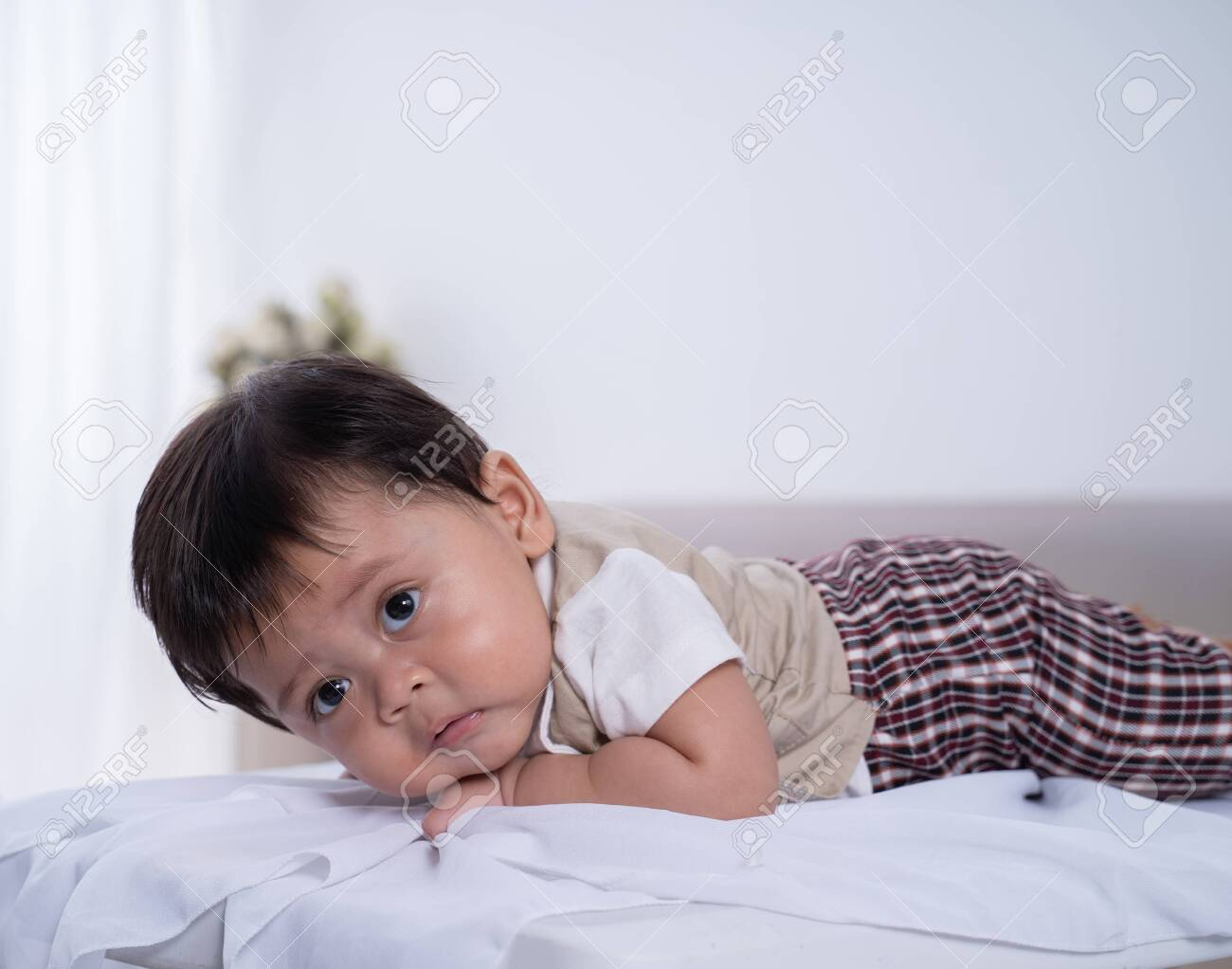 asian baby boy lying on his stomach - 138627469