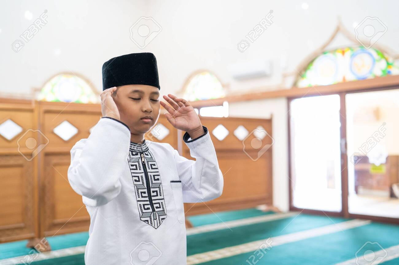 muslim kid praying in the mosque stock photo picture and royalty free image image 145762737 muslim kid praying in the mosque stock photo picture and royalty free image image 145762737