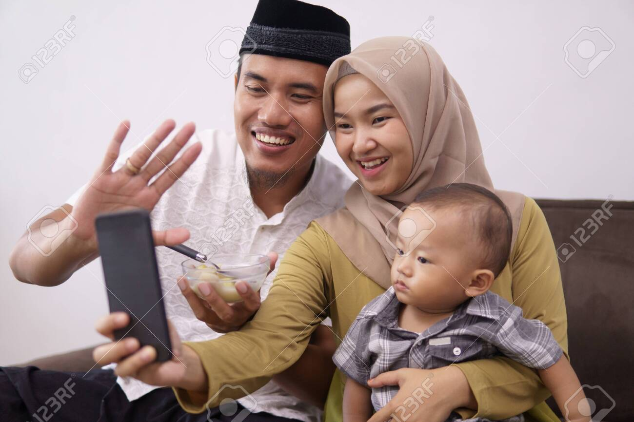 family muslim make a video call with family - 146095882