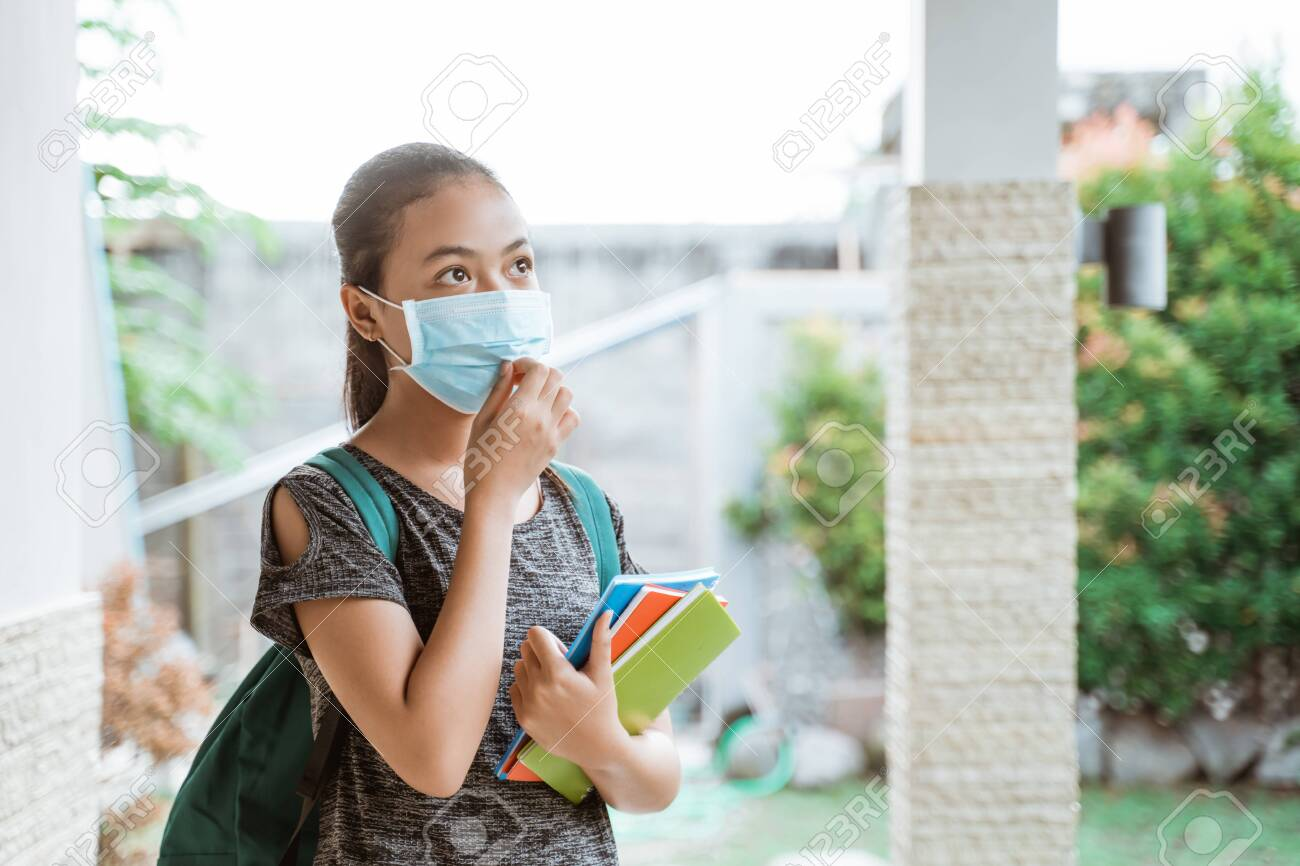 Asian student girl wears a mask with backpack take away books - 153667437