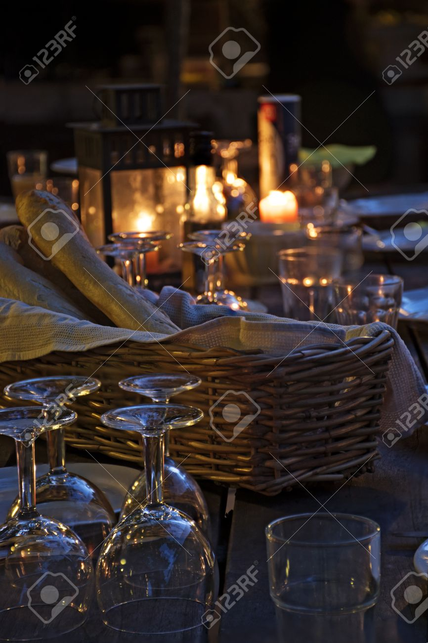 Candle light dinner table for two - Candlelight Prepared Table For A Rustic Outdoor Dinner At Night With Wineglasses Bread And