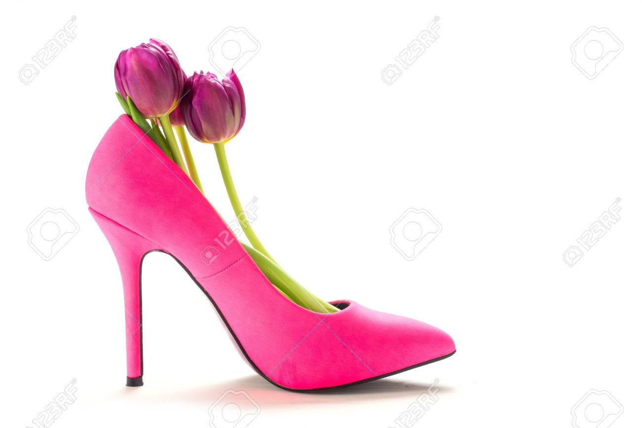 f7138e6dabd Ladies pink high heel shoe in profile with tulips inside, isolated..