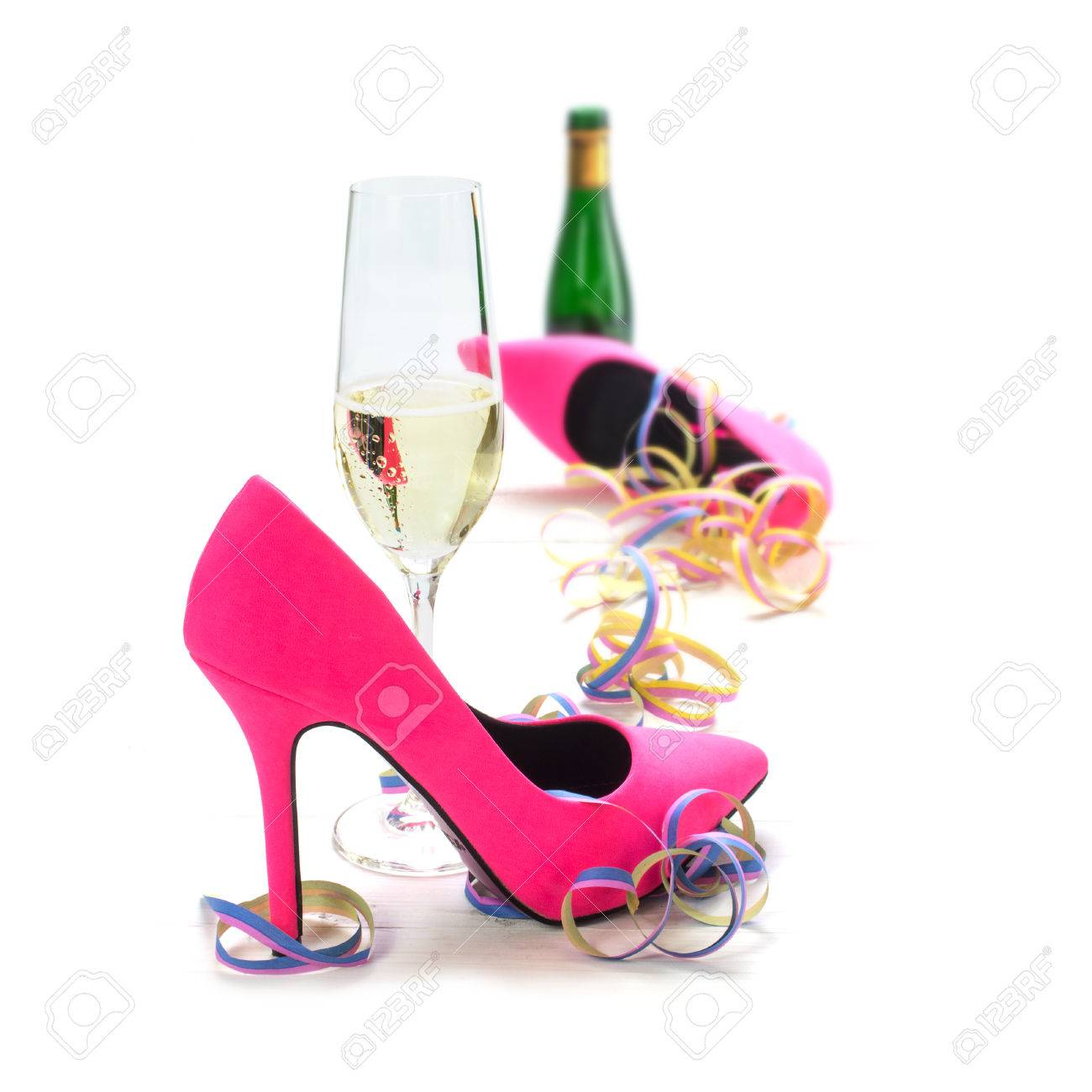 41cb2575c0 Stock Photo - women's day party, ladies pink high heels shoes, streamers,  champagne glass and bottle, isolated on a white background, selected focus,  ...