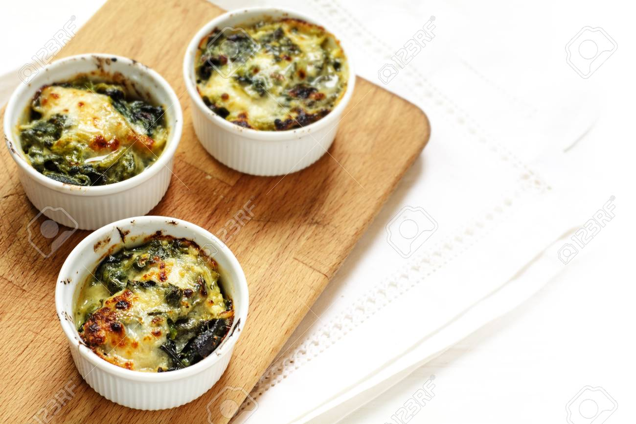 Baked Spinach With Cheese Crust In Three Small Casserole Dishes