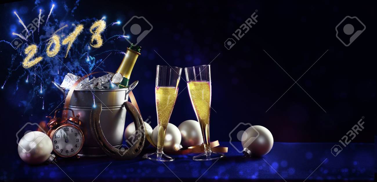 new year celebration background banner with text 2018 champagne bottle and glasses christmas decorations