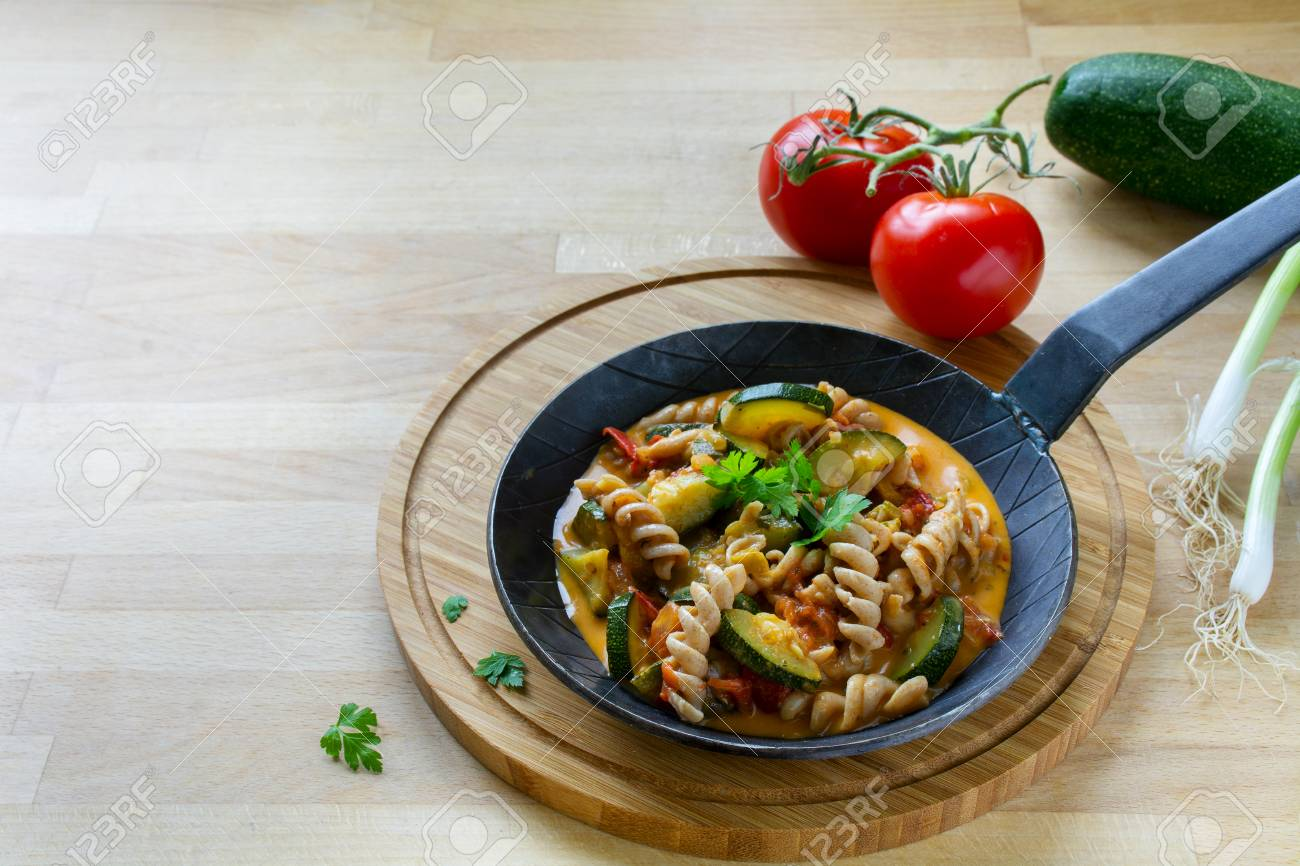 Wholemeal Pasta With Zucchini And Tomato Vegetables In A Small ...