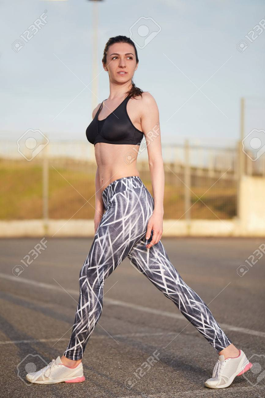 3f3f7047a3f7f Stock Photo - young female runner with perfect figure dressed in sport bra  and shorts