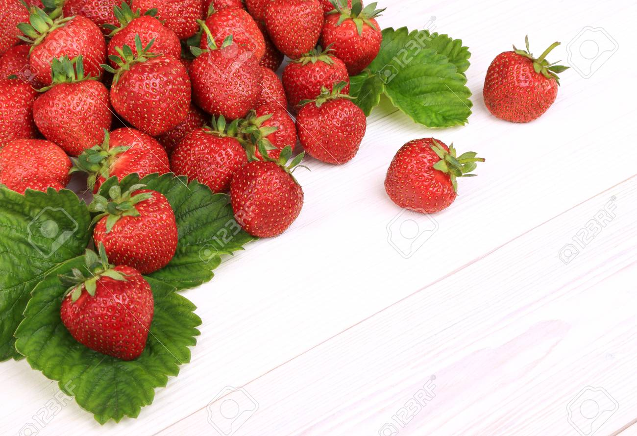 strawberries sprinkled on a white wooden background Stock Photo - 20335615