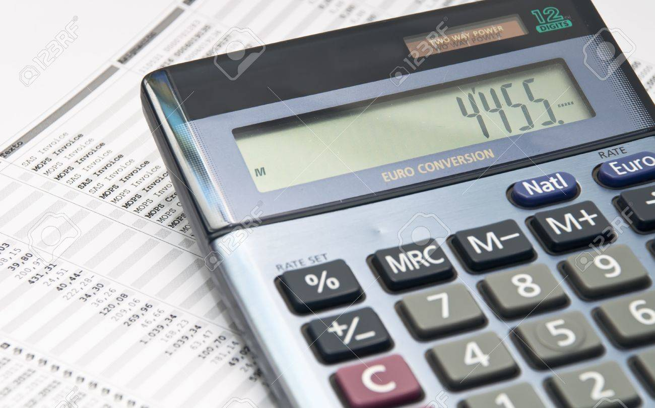 Economic Background With Calculator And Paper With Numbers Stock ...