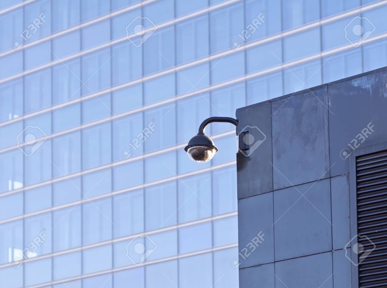 Security video camera Against modern building Stock Photo - 13815586