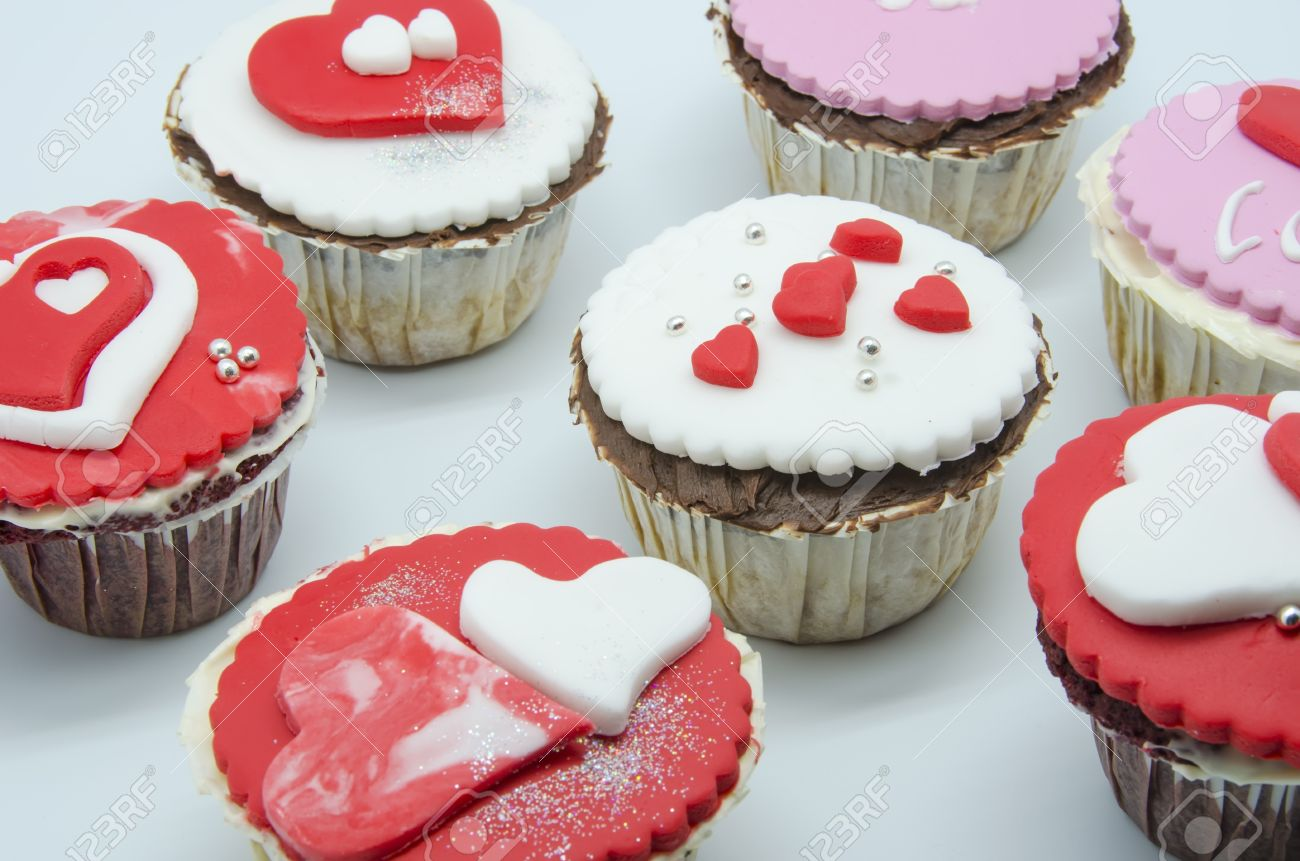 Gourmet cupcakes with hearts and decorations Stock Photo - 17594506