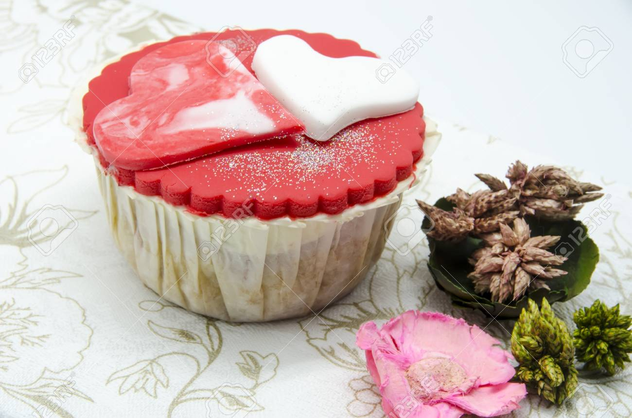 Gourmet cupcakes with hearts and decorations Stock Photo - 17594510