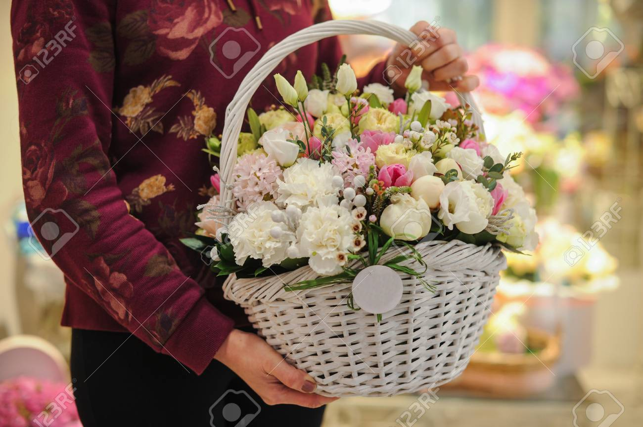 Big basket with white light flowers bouquet in hands stock photo big basket with white light flowers bouquet in hands stock photo 48937156 izmirmasajfo