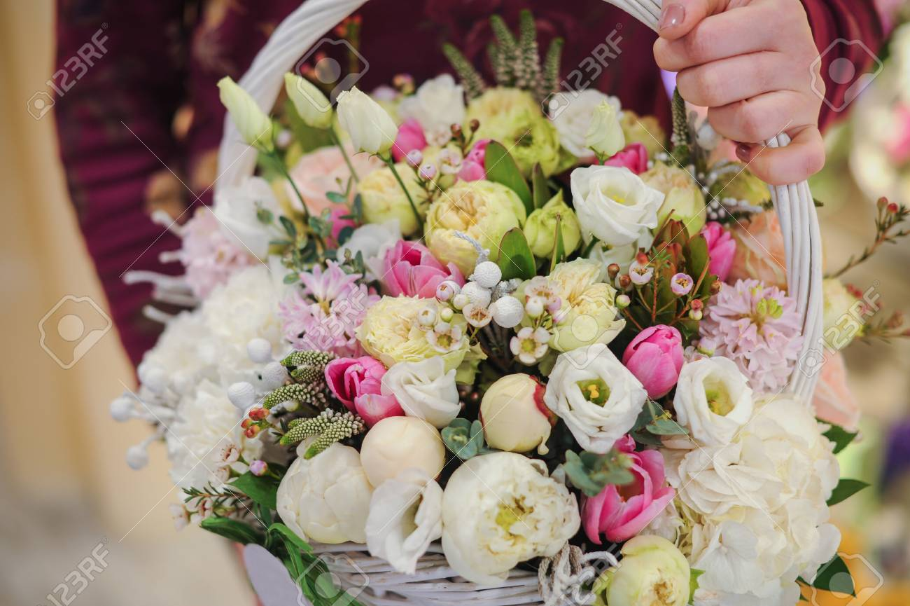 Big Basket With White Light Flowers Bouquet In Hands Stock Photo ...